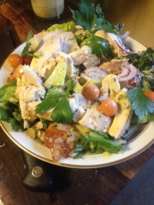 Chicken Salad with fresh cherry tomatoes, avocado, red onion, parsley and basil.,