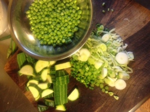 Mis en place.  Peas shelled, zucchini sliced, fennel, garlic scapes and green onions minced.
